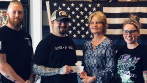 Pair-A-Dice Tattoo Shop Donates to Spaulding Youth Center