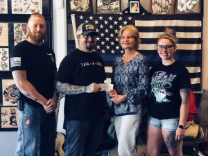 Spaulding Youth Center Receives Donation from Pair-A-Dice Tattoo Company